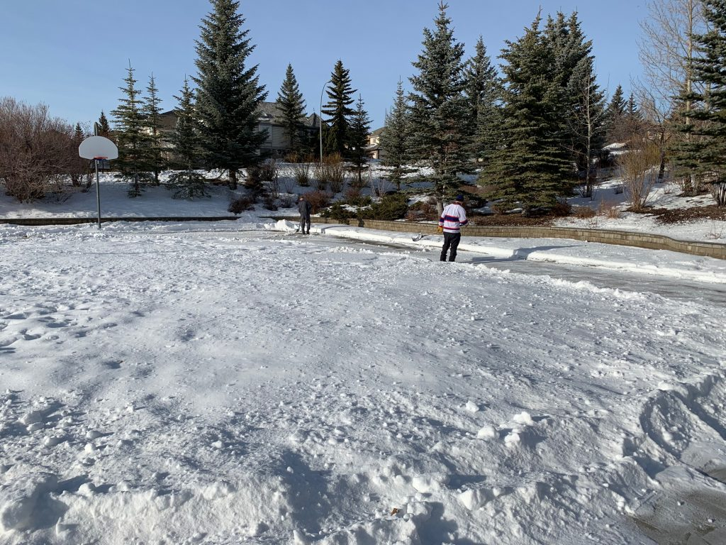 Volunteers getting the rink ready 2021